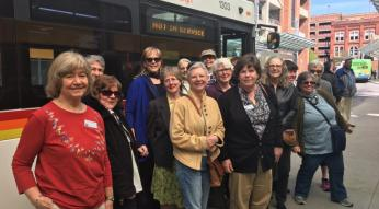 League of Women voters in front of bus