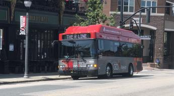 Red and gray GoRaleigh bus with R-Line banner